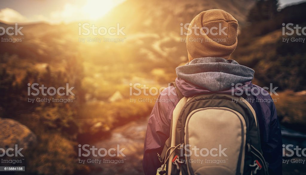 Wandering in the wilderness at sunset stock photo