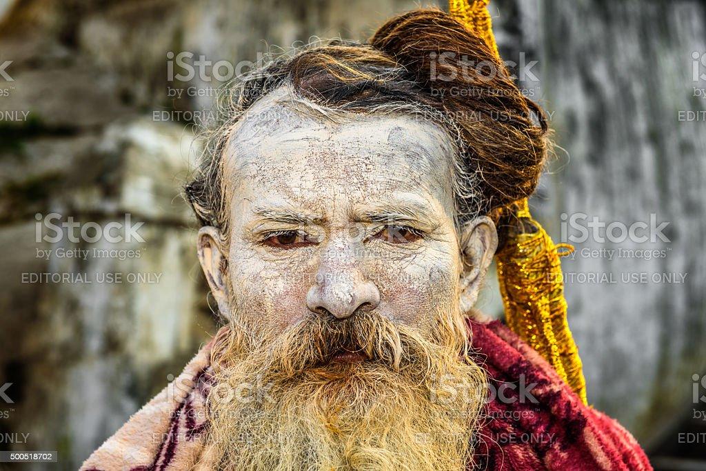 Wandering  Shaiva sadhu (holy man) in ancient Pashupatinath Temp stock photo