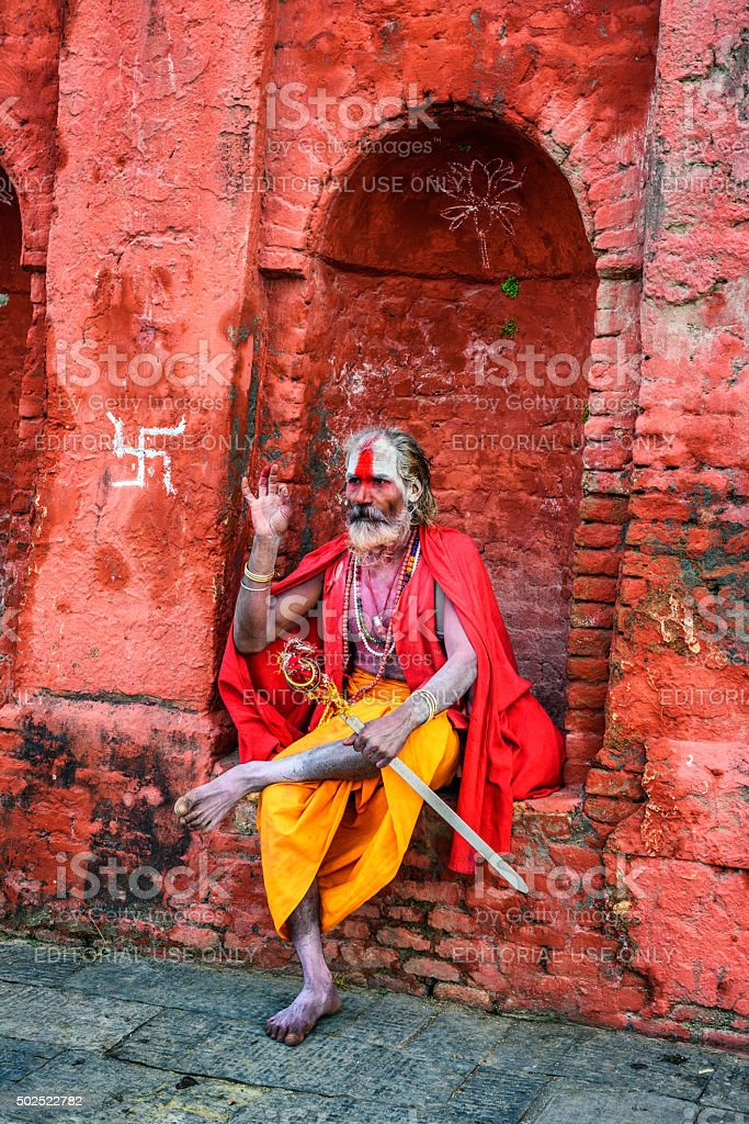 Wandering  Shaiva sadhu (holy man) in ancient Pashupatinath Temple, Nepal stock photo