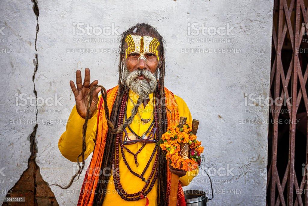 Wandering  Shaiva sadhu (holy man) shows his long beard stock photo