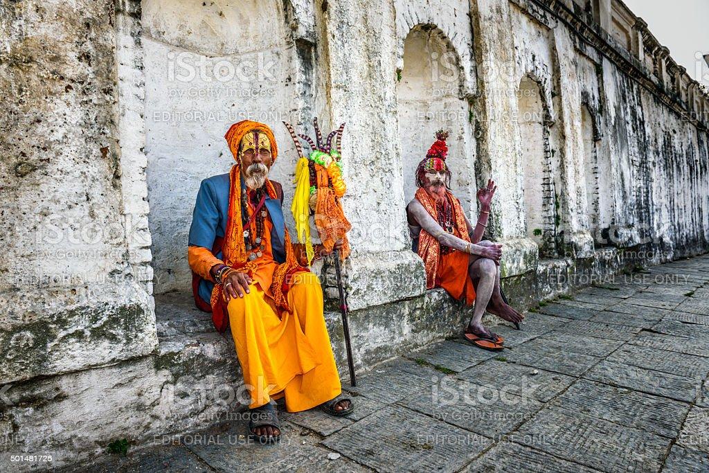 Wandering  Shaiva sadhus (holy men) in ancient Pashupatinath Temple, Nepal stock photo