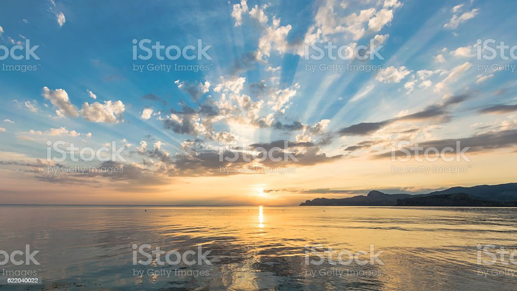 Waning candles of the calm day on the sea stock photo