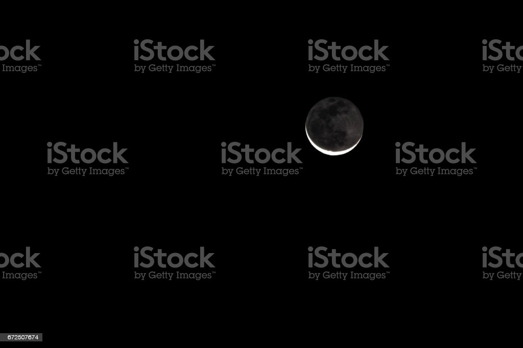 Waning Crescent Moon Lunar Eclipse stock photo