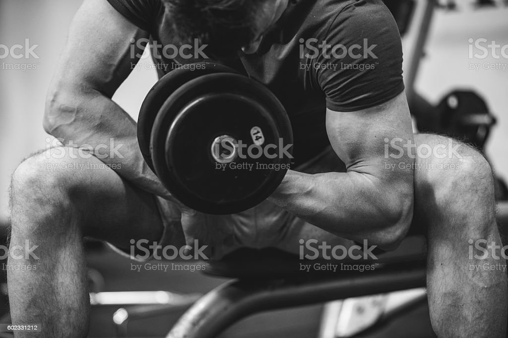 I want my biceps to be bigger stock photo
