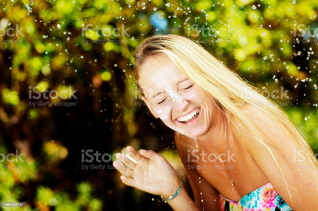Want to avoid skin cancer? Use sunscreen, preferably waterproof. stock photo