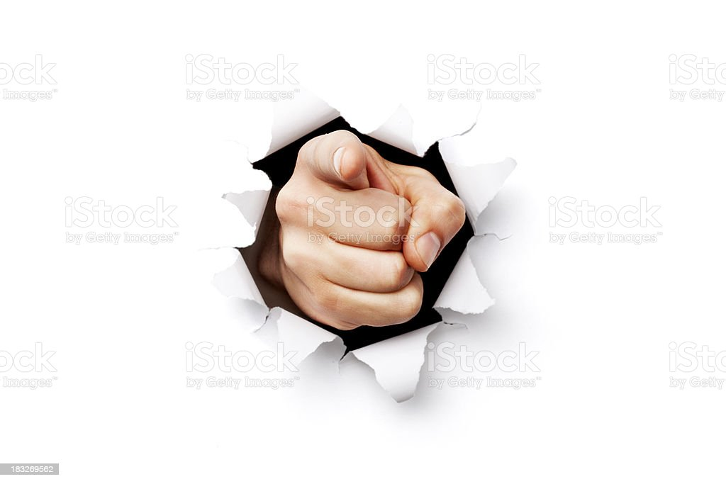 I want you finger coming through torn paper stock photo