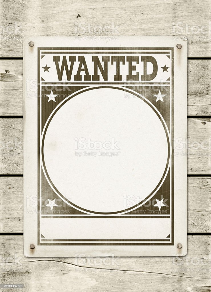 Wanted poster on a wood board stock photo
