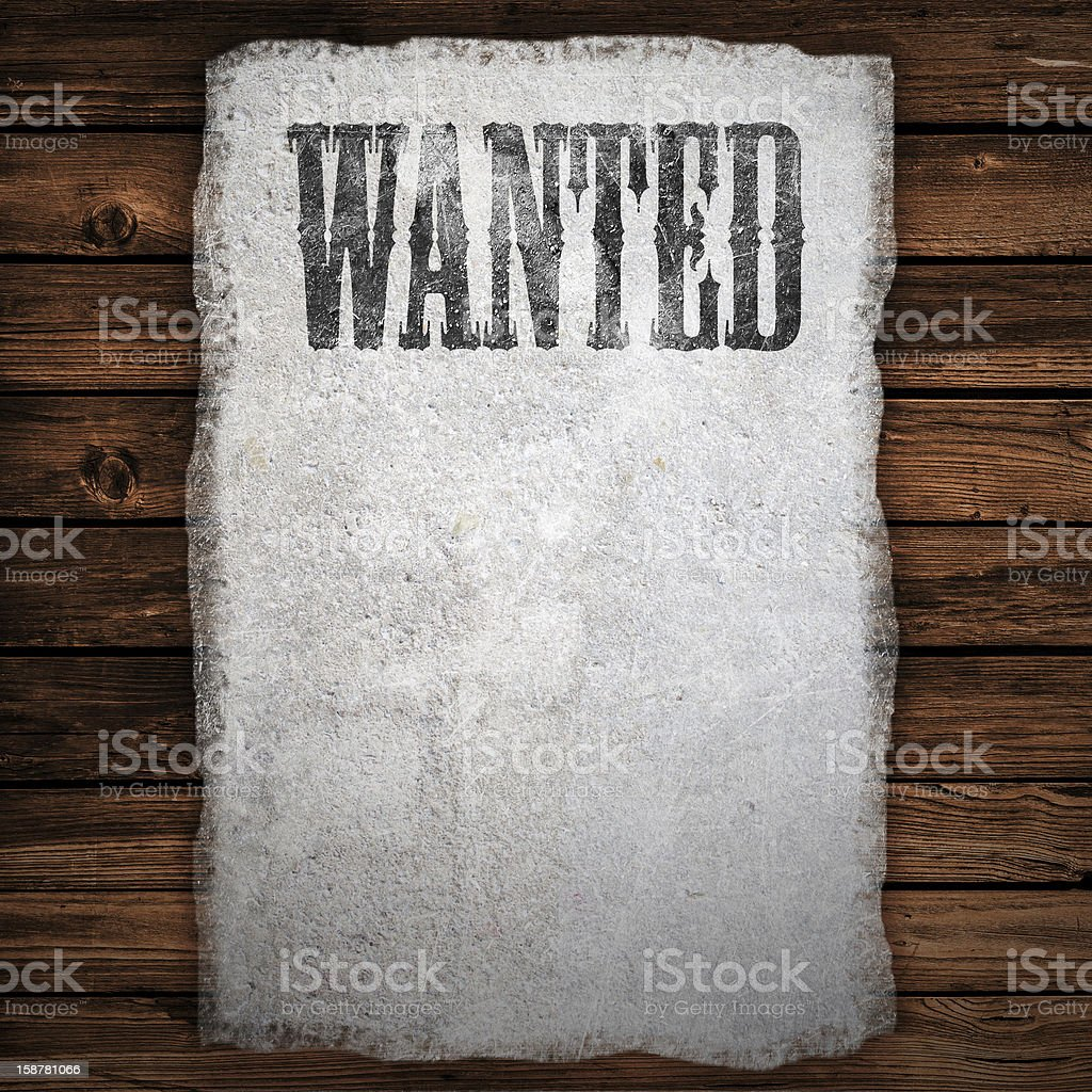 Wanted sign on wooden wall stock photo
