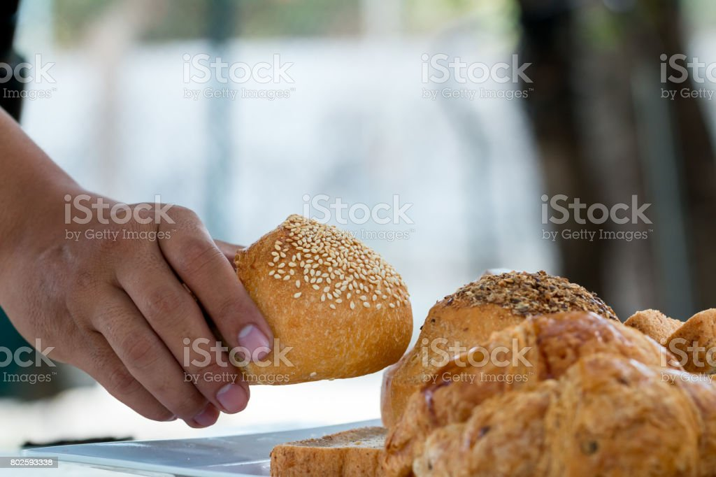 wanting to take loaf bread for eating stock photo