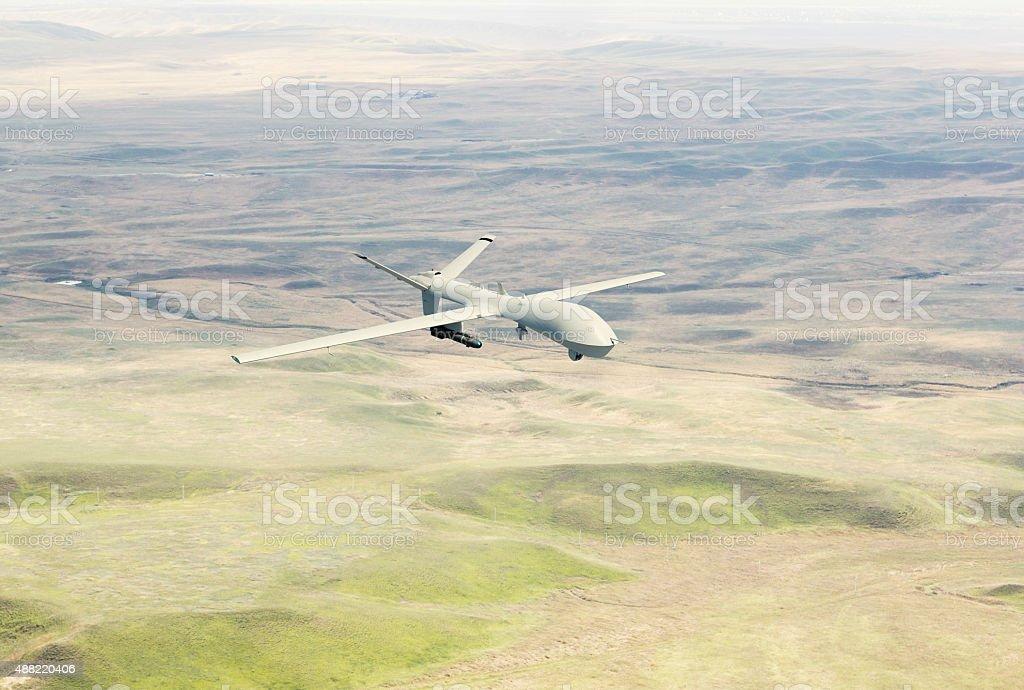 War drone flying over the desert stock photo