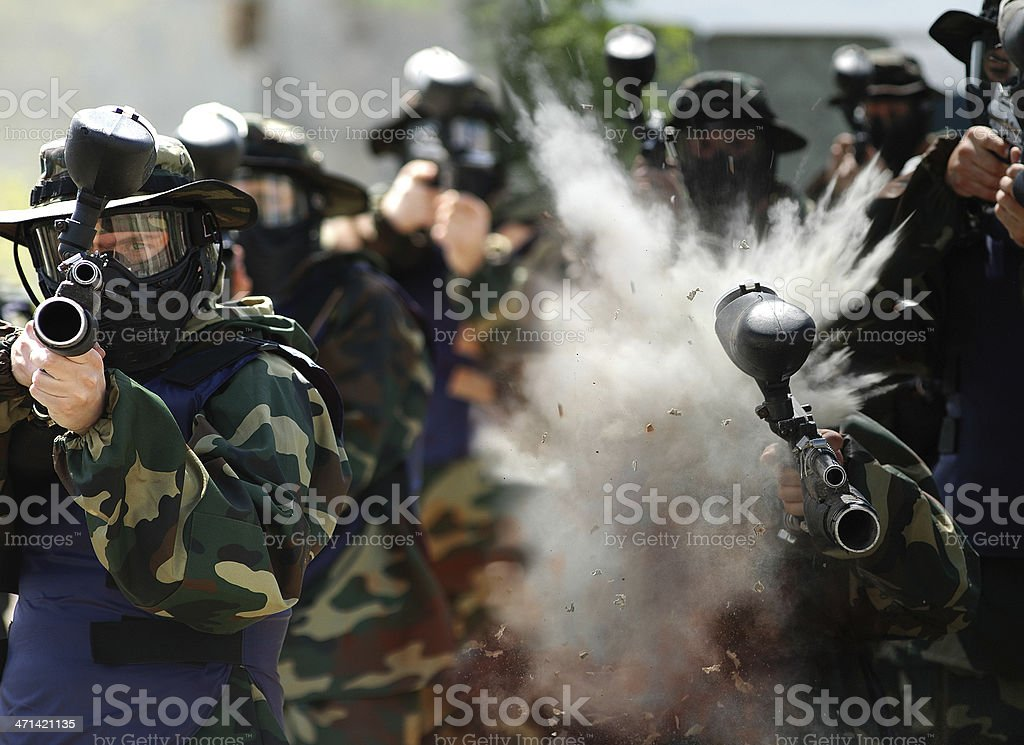 War Games. Direct hit in paintball player. stock photo