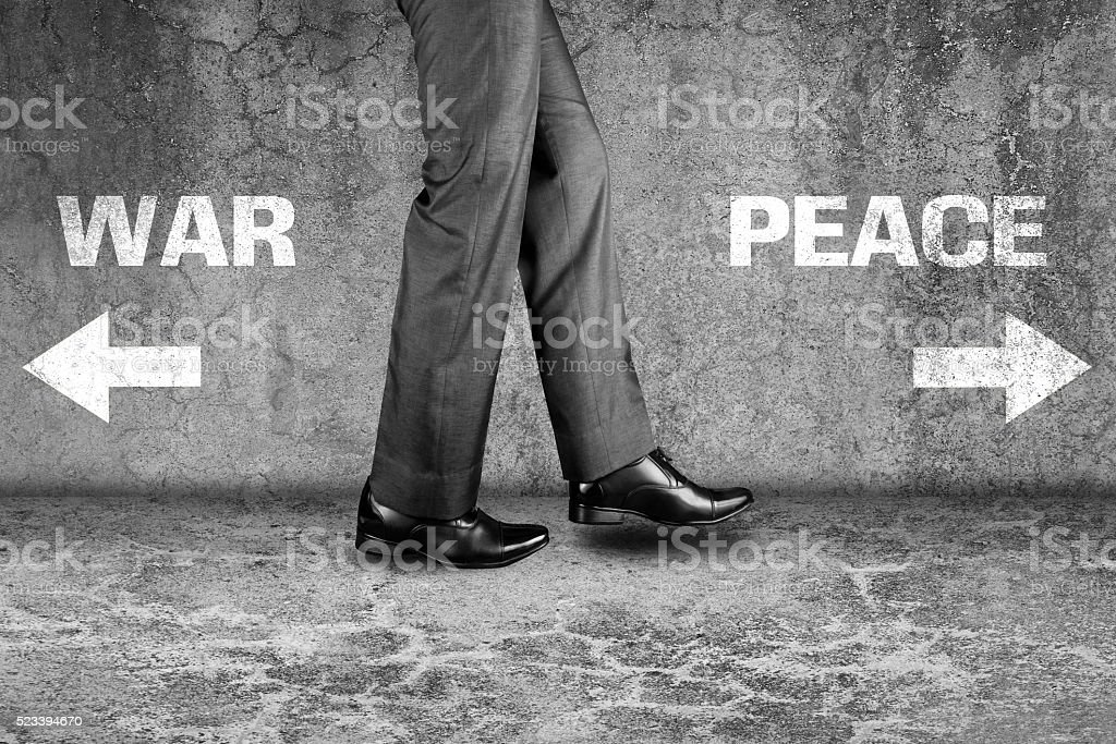 War or Peace way written text on dirty wall stock photo