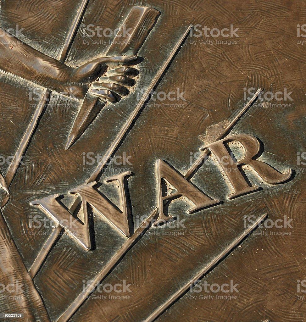 War text on bronze sculpture royalty-free stock photo