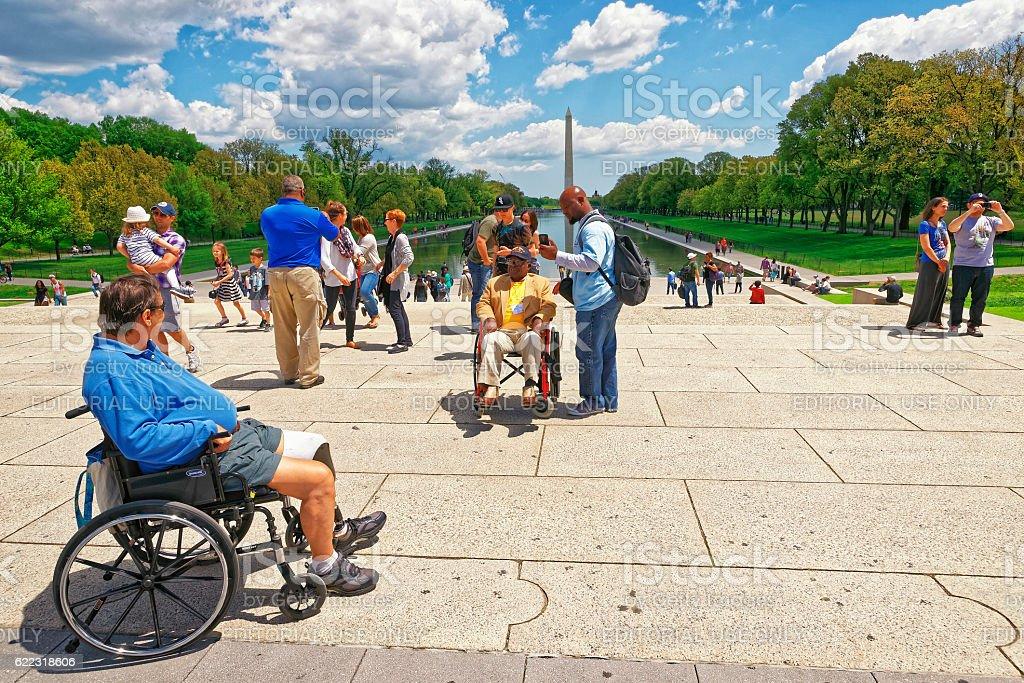 War veteran next to Lincoln Memorial Reflecting Pool stock photo