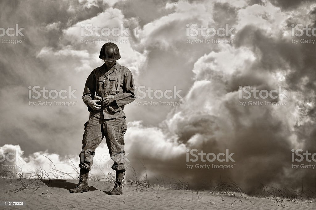 War Weary WWII Soldier During A Retrospective Moment stock photo