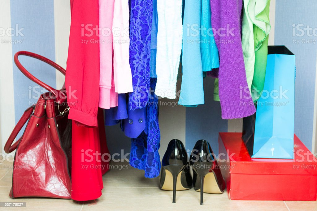 Wardrobe with summer clothes nicely arranged stock photo