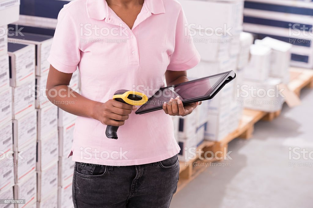 Warehouse and logistics control. Storekeeper woman at work. stock photo