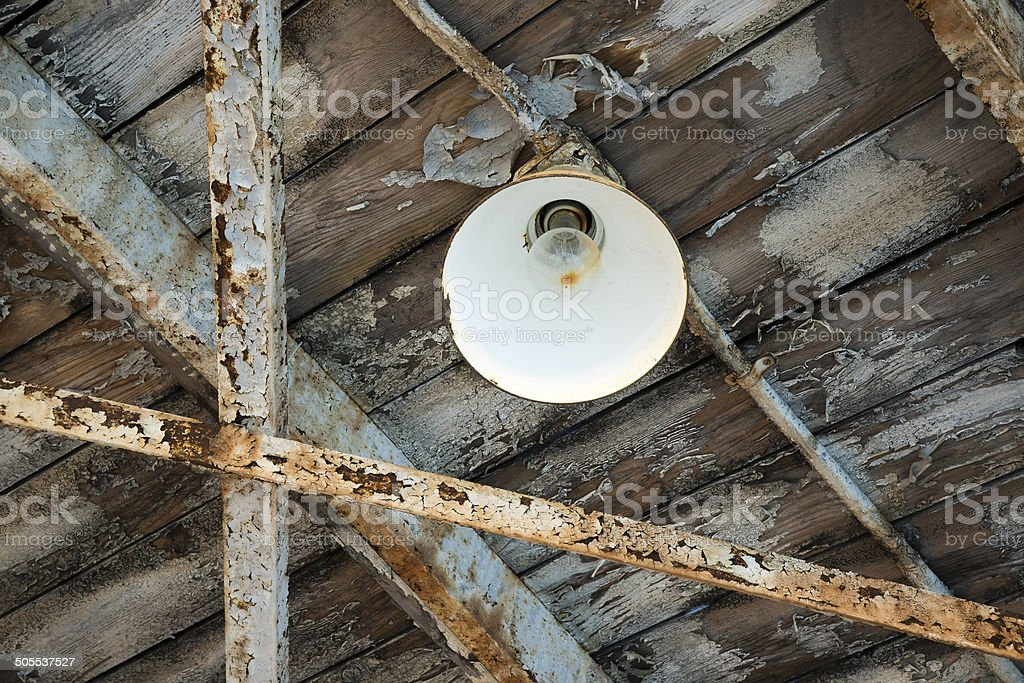Warehouse Ceiling Light at a Dilapidated Abandoned Factory stock photo