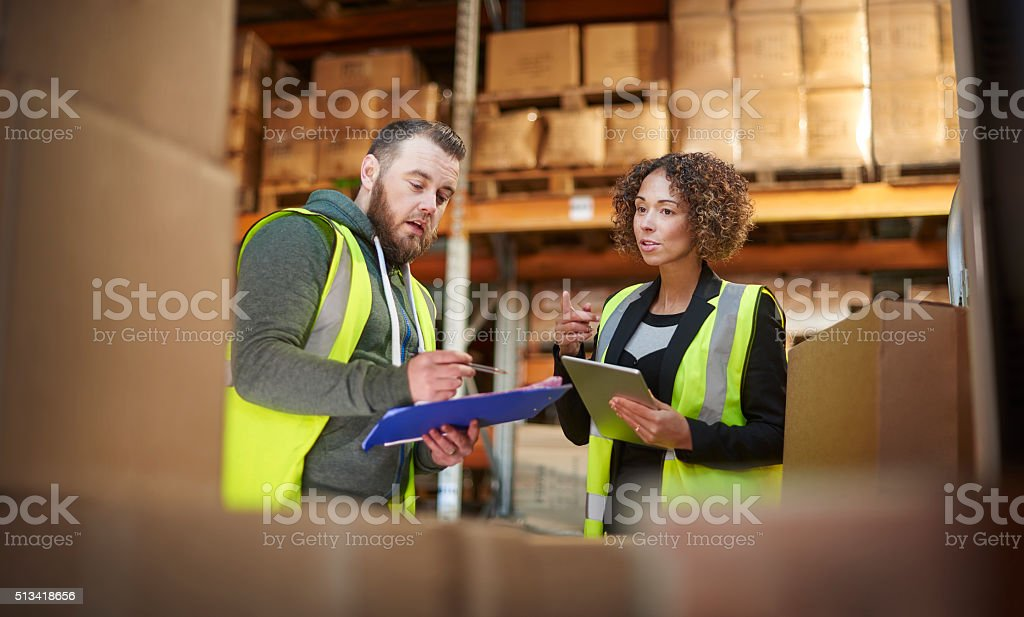 warehouse discussion stock photo
