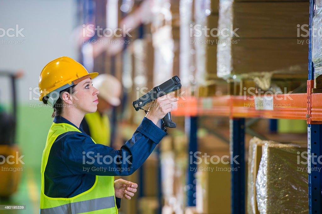 Warehouse Employee Scanning Boxes stock photo