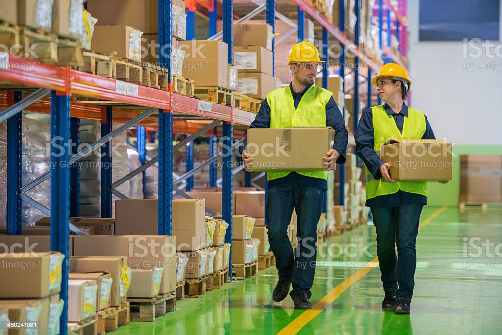 Warehouse Employees Wih Boxes stock photo