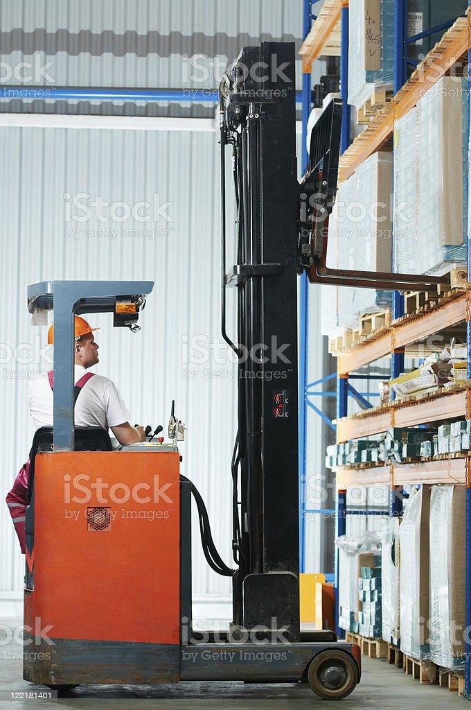 warehouse forklift loader at work royalty-free stock photo