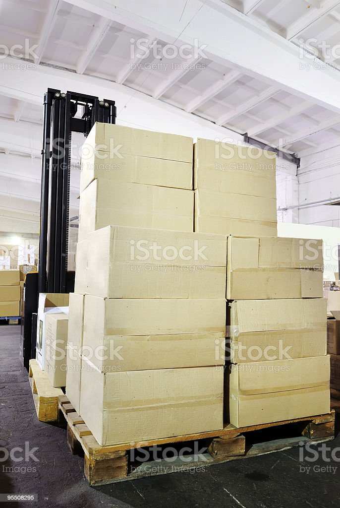 warehouse forklift stacker with boxes royalty-free stock photo