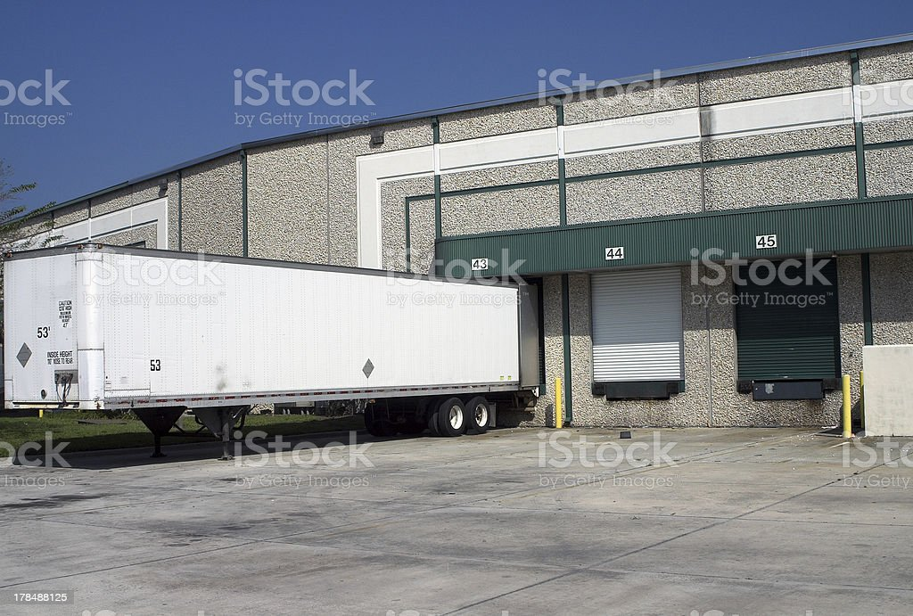 Warehouse loading bays with trailer stock photo
