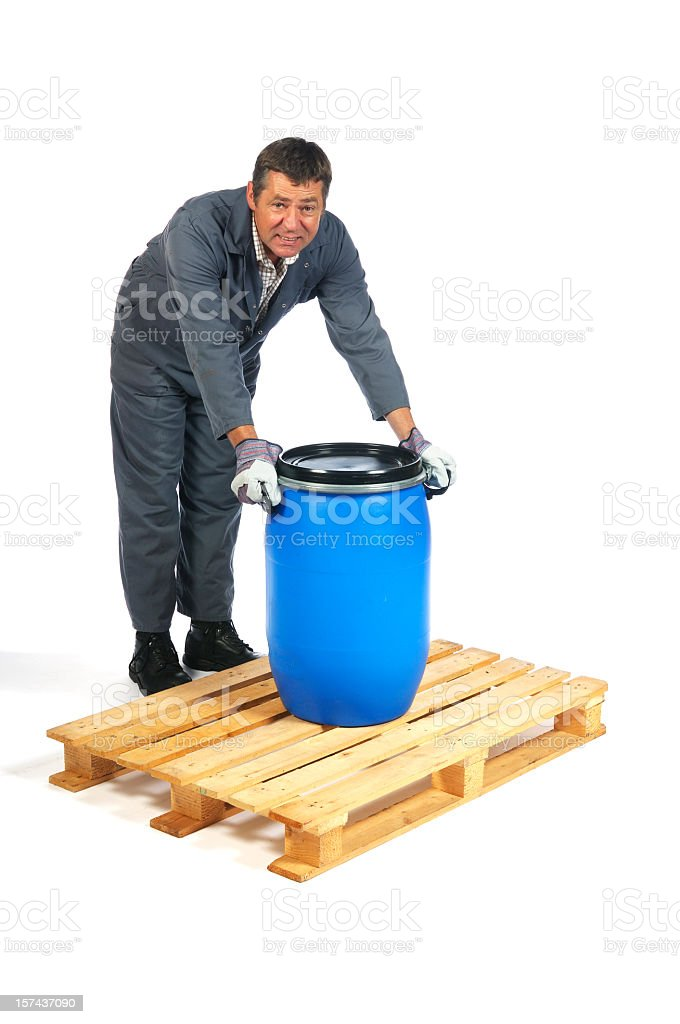 Warehouse Man about to Lift Badly stock photo