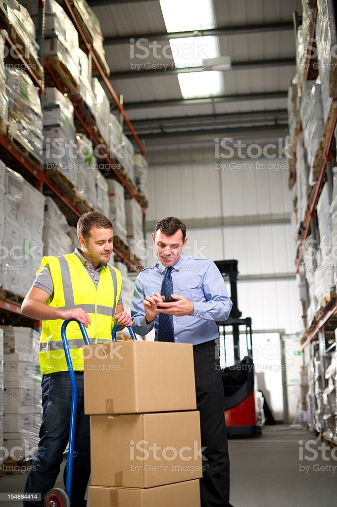 Warehouse Manager and Worker royalty-free stock photo