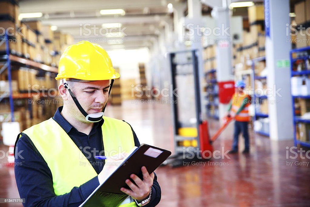 Warehouse manager and worker stock photo