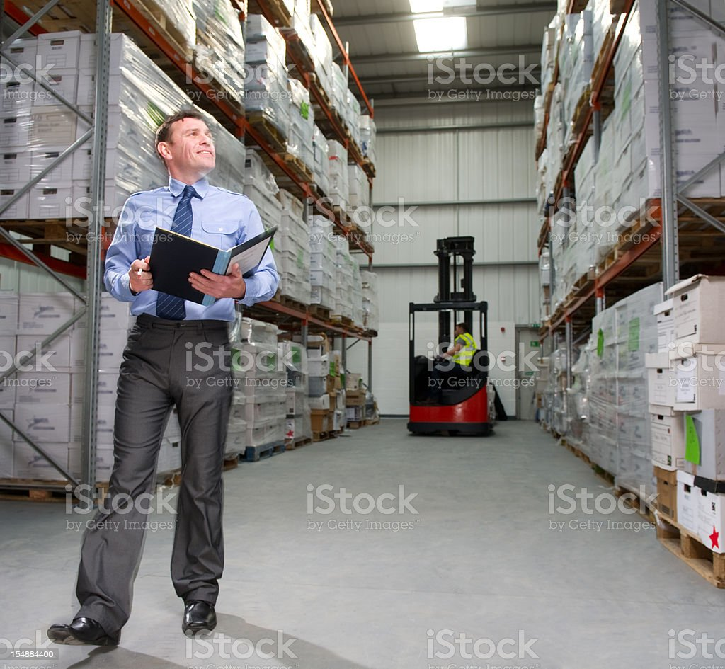 Warehouse Manager Counting Inventory royalty-free stock photo
