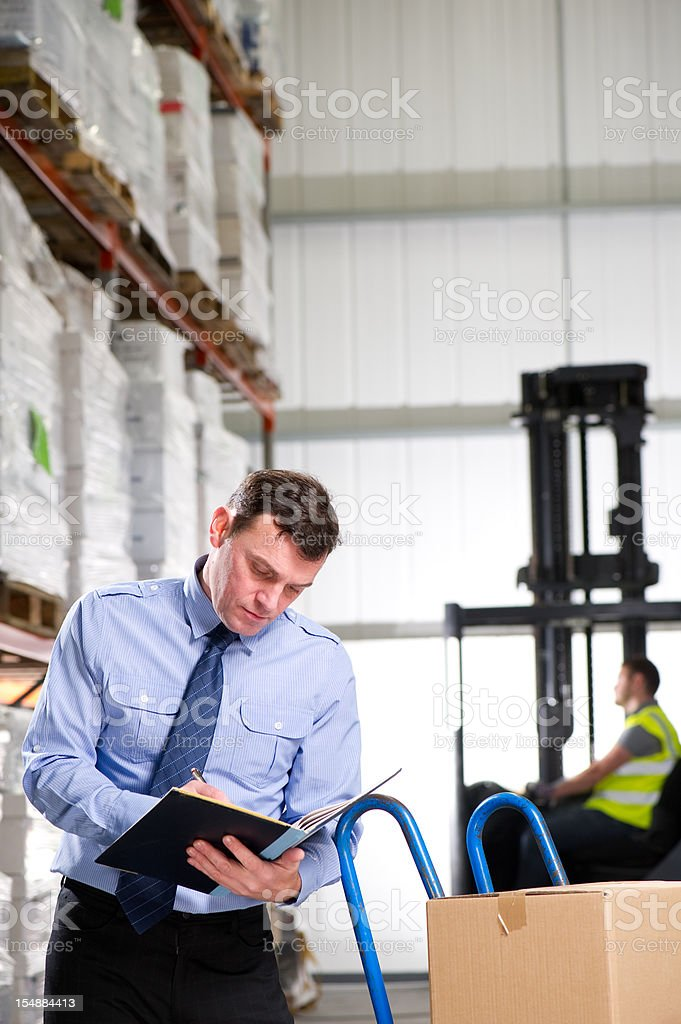 Warehouse Manager with a Hand Truck royalty-free stock photo