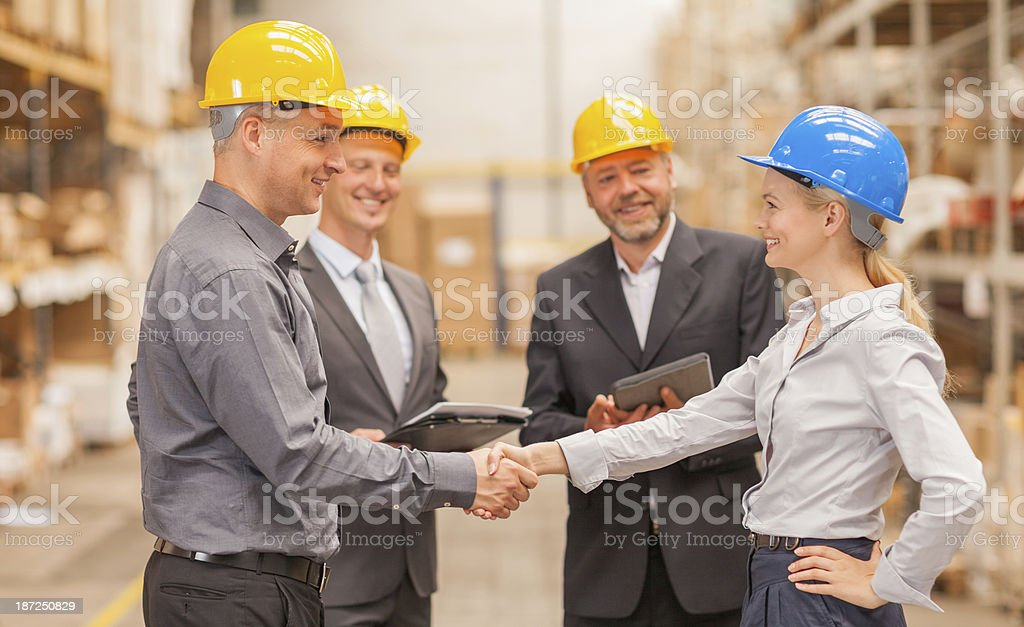 Warehouse managers shaking hands royalty-free stock photo
