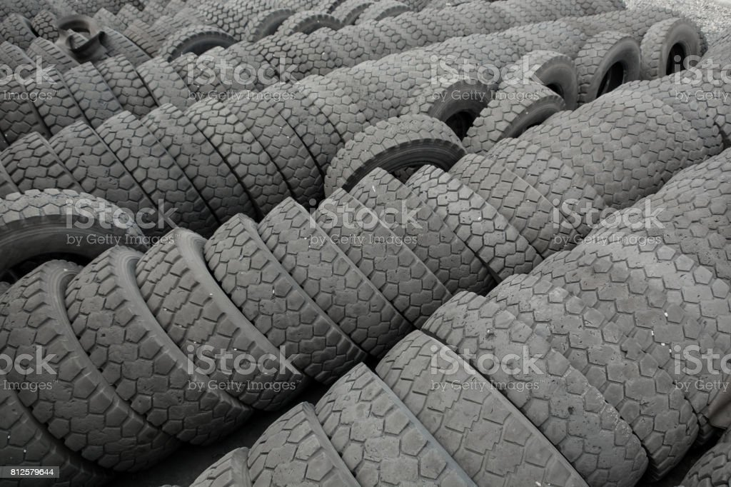 Warehouse of old used tires outdoors, old wheels stock photo