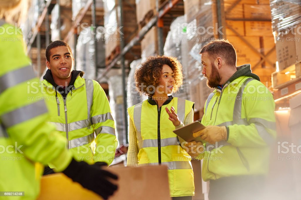 warehouse staff chat stock photo
