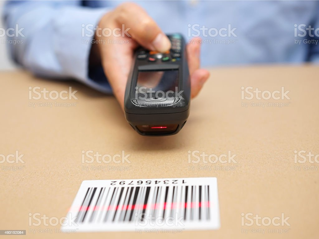 warehouse technician inspects stocks in storage with bar code reader stock photo
