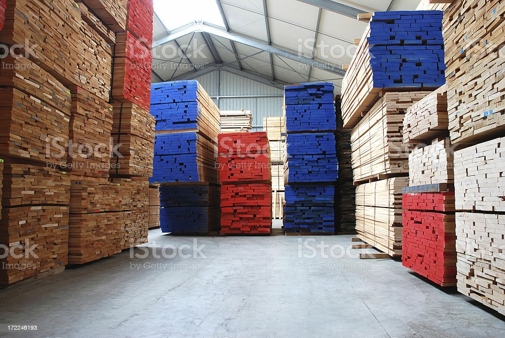 Warehouse with stacks of  beech boards royalty-free stock photo