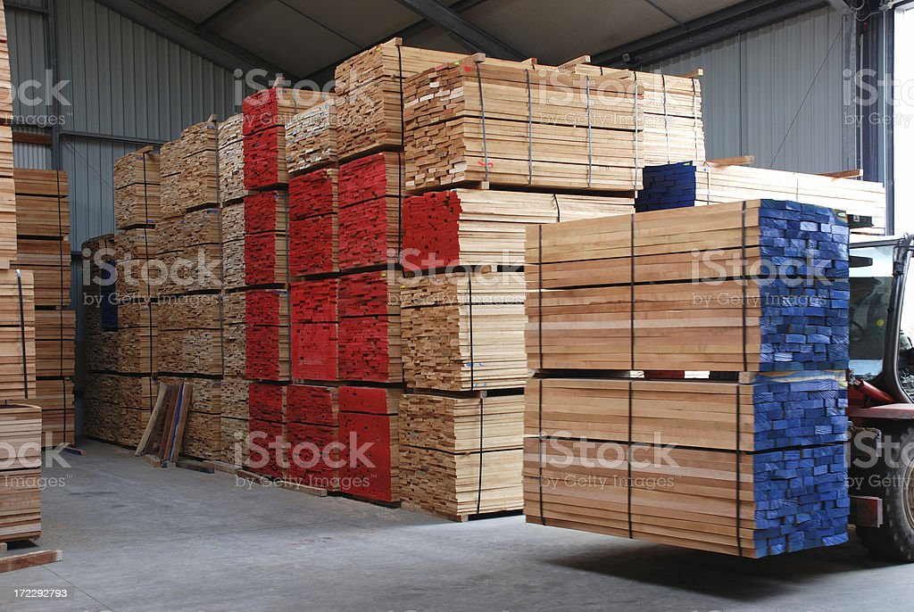 Warehouse with stacks of  boards royalty-free stock photo