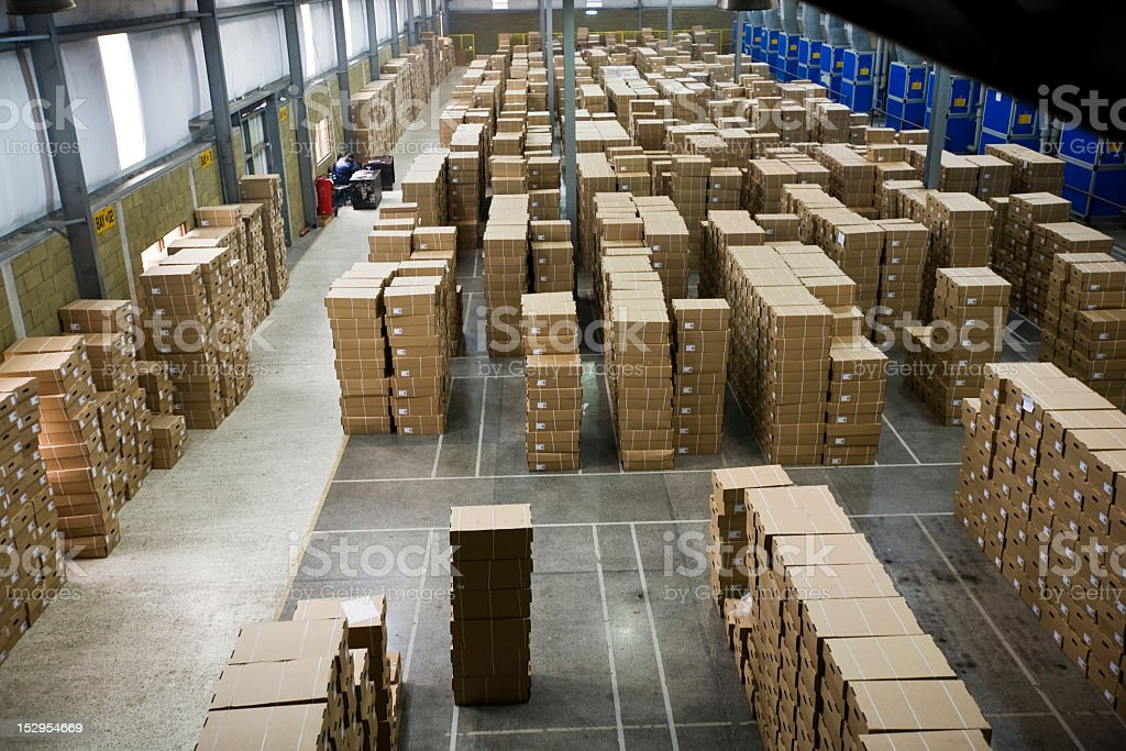 Warehouse with stacks of boxes stock photo