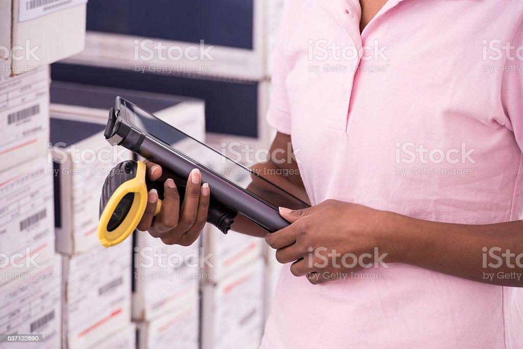 Warehouse woman at work. stock photo