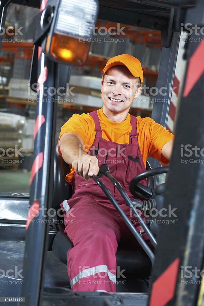 warehouse worker driver in forklift royalty-free stock photo