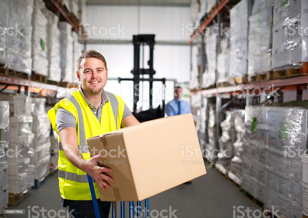 Warehouse Worker Holding a Box royalty-free stock photo