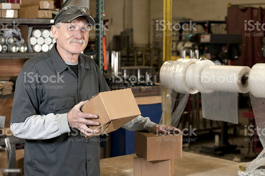 Warehouse Worker in Shipping Department royalty-free stock photo