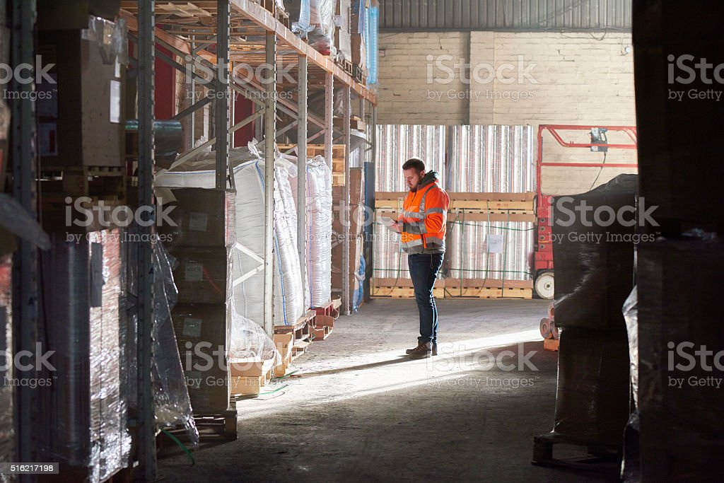 warehouse worker in warehouse stock photo