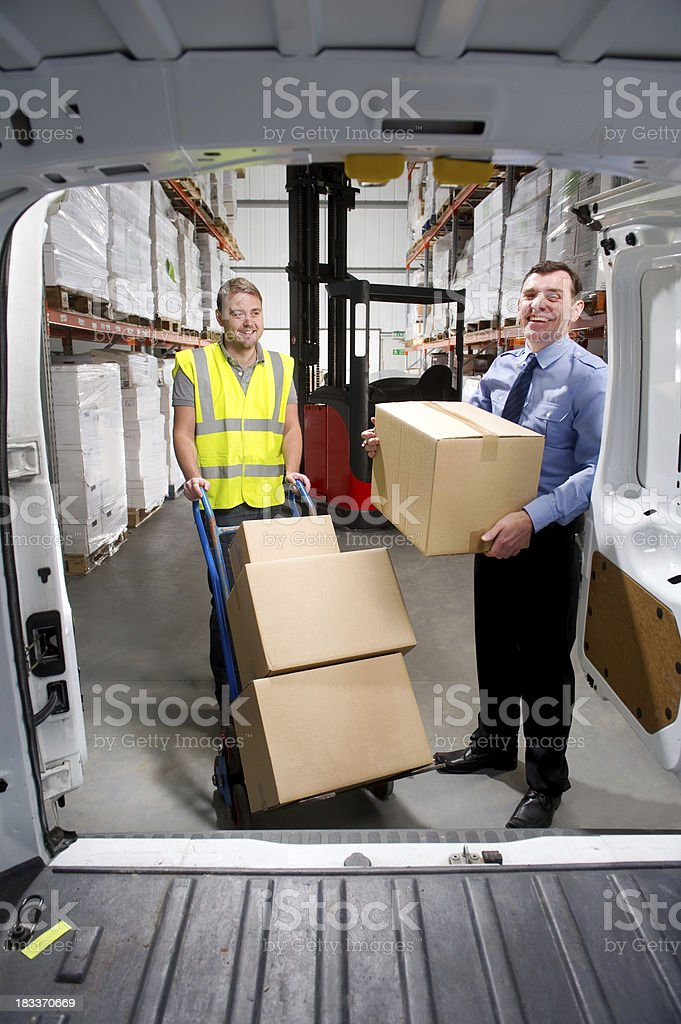 Warehouse Worker Loading a Delivery Van royalty-free stock photo