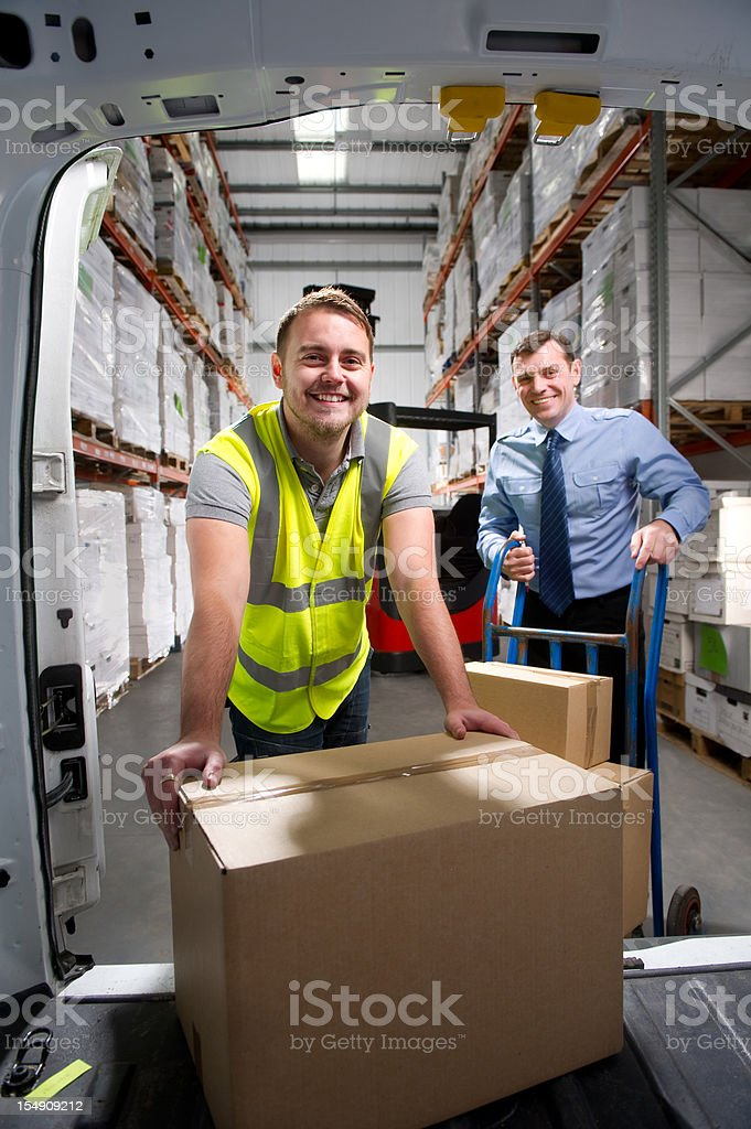 Warehouse Worker Loading Delivery Van royalty-free stock photo