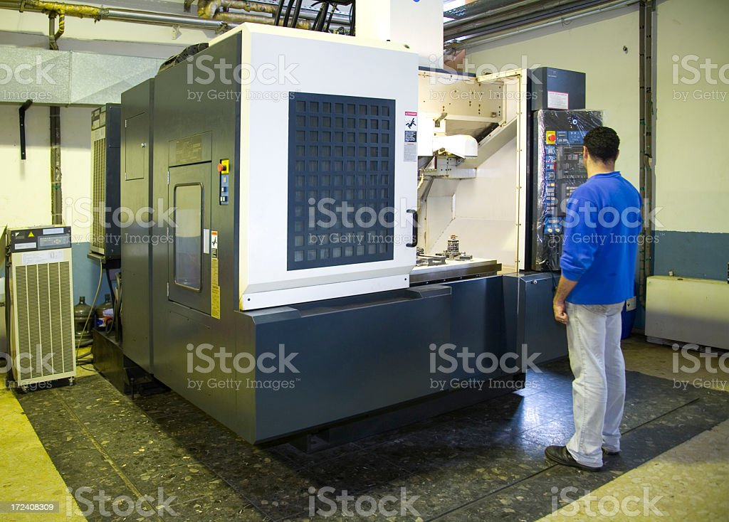 A warehouse worker on a production line stock photo