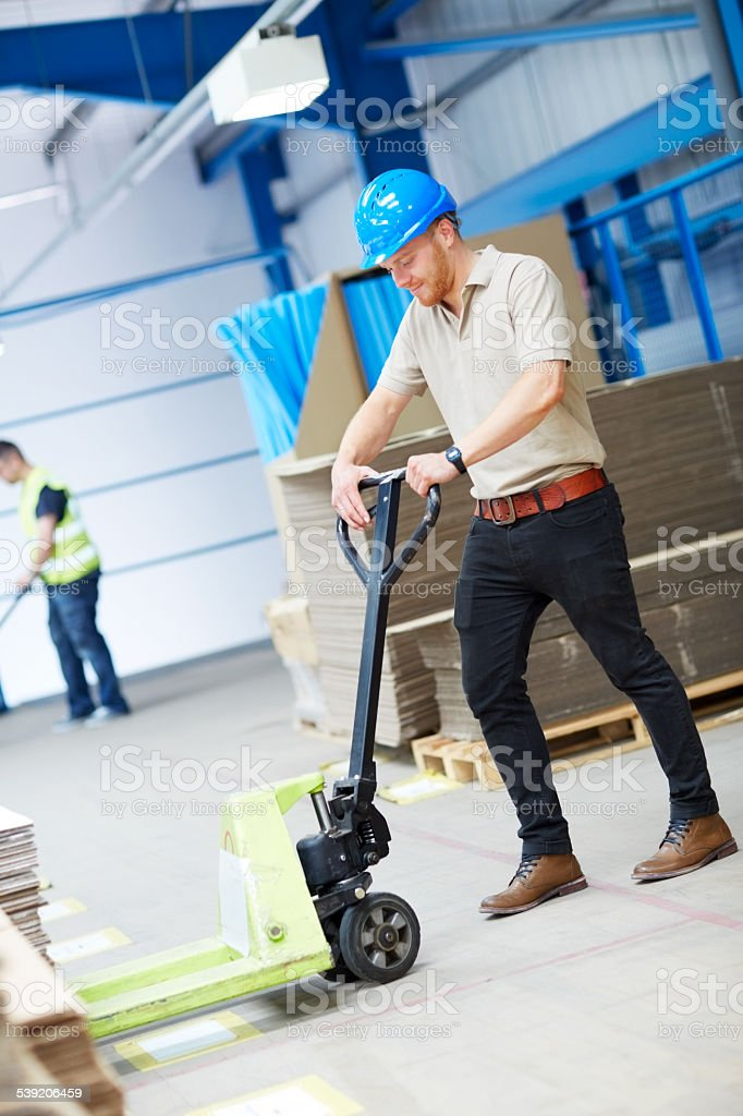 Warehouse worker organizing stock stock photo