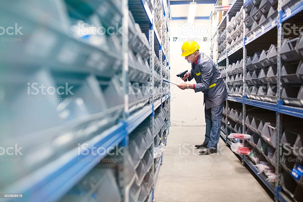 warehouse  worker scanning   with bar code reade stock photo